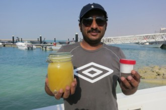 Ali Mubarak Al-Kuwari from the Qatar ministry of Environment with plankton samples. The jar to the left contains fish eggs from a 3 minute tow within a whale shark aggregation zone. The container to the right contains plankton from a tow taken after the sharks left the area and contains hardly any fish eggs.